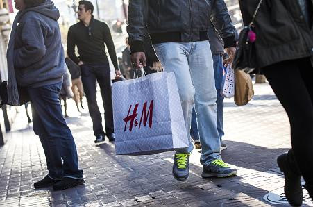 H&M's first-quarter profit plunges as it warns of more price cuts ahead