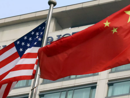 China warns US 'opening fire' on world with tariff threats