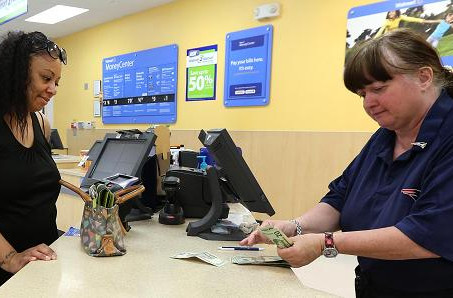 Walmart takes its money transfer service global