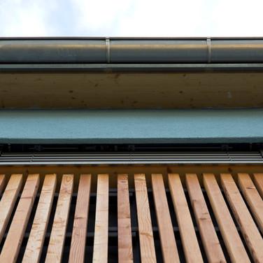 Verputz und Holz für die Fassade