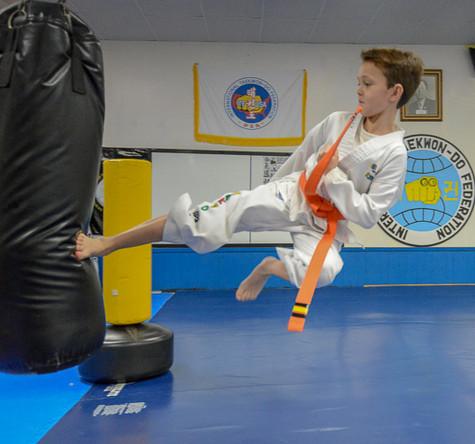 High flying kick to bag