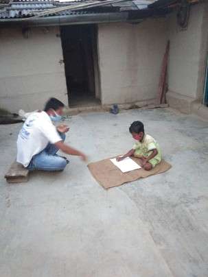 Our Volunteers are helping children in their studies while maintaining Social distancing