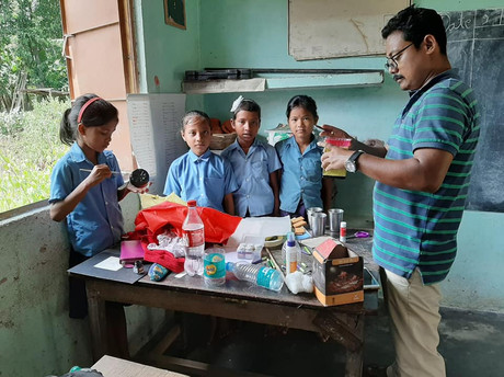 Students using waste to decorate their classroom