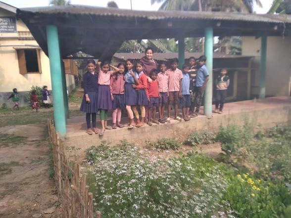 Children are happy to show their kitchen garden to our team