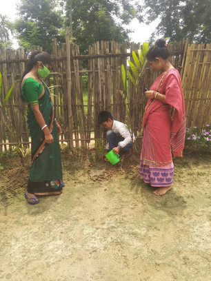 Happy World Environment day !  Child planting trees with help from our volunteer