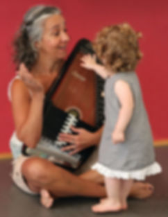 Young children are curious about where the music comes from. In our classes they are free to touch and explore the instruments.