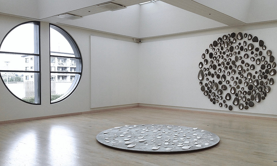Source - Pluvial 2014 installation in 3 parts; sea stone and silver leaf, wood, paper and porcelain, window each is 300x300x20cm