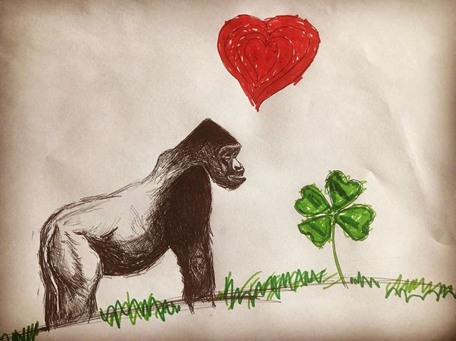 Doodle of Gorilla with heart and four leaf clover