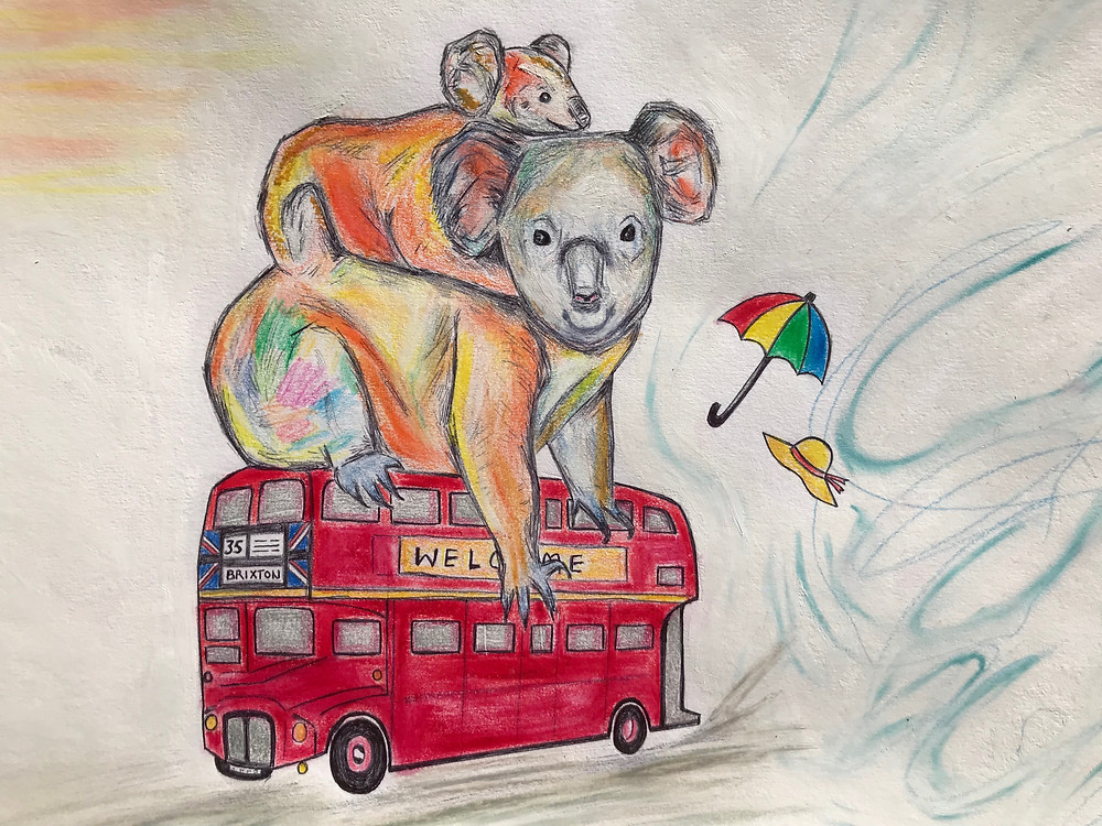 Koala with baby on it's back sitting on a red London bus