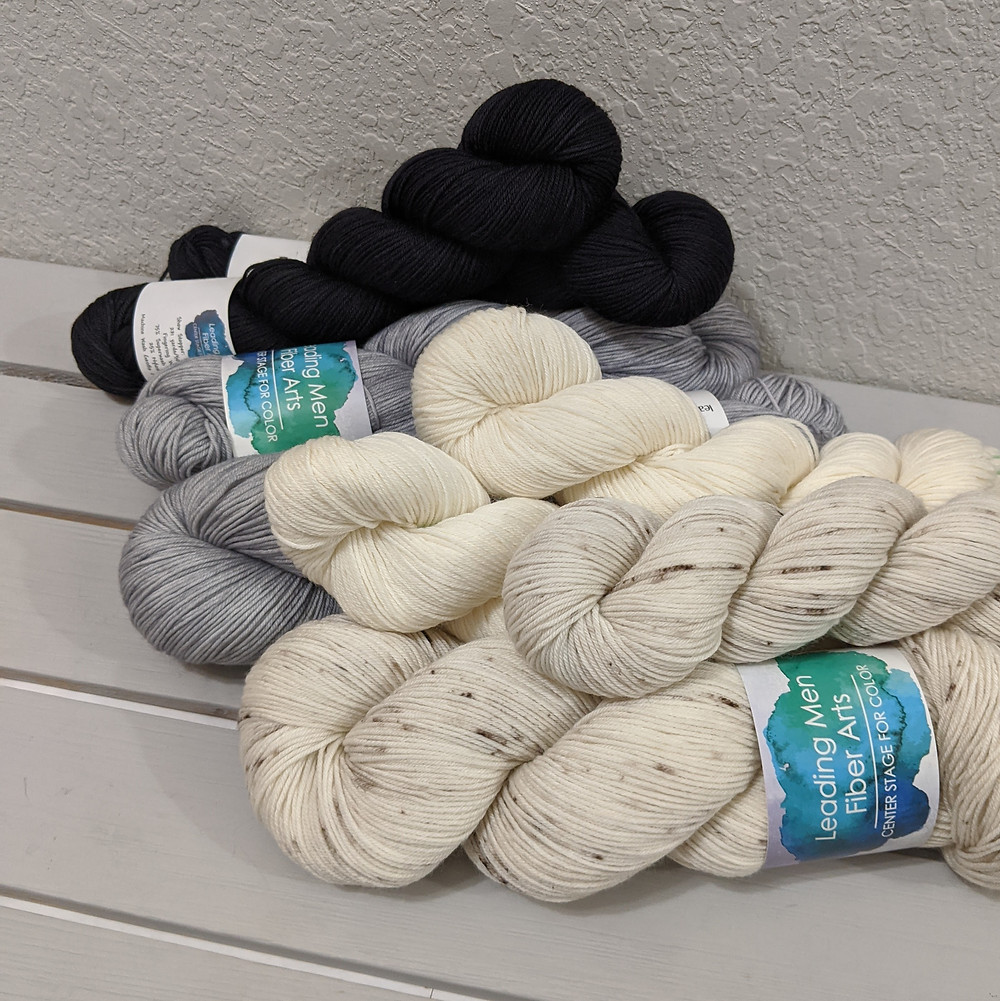 Showstopper Yarn from Leading Men Fiber Arts in Sand Dollar, Bare Necessities, Smoke on the Water, and Darkest Hour