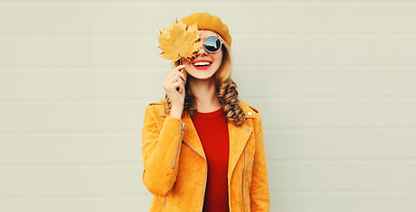 Autumn mood! happy smiling woman holding