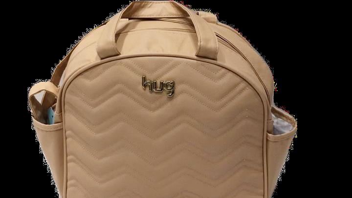 Bolsa grande com bolsos laterais e trocador