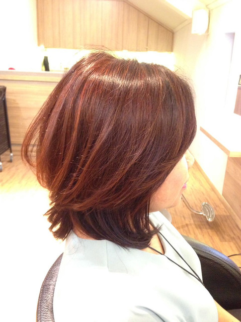 Healthy light red brown color. A cut to sharpen her face