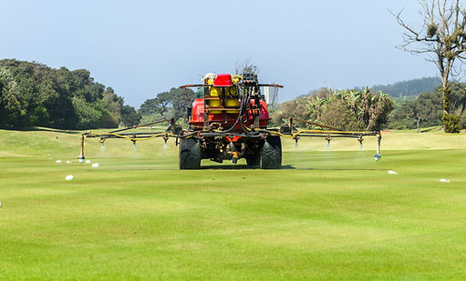 Golf course hole machine operator sprayi