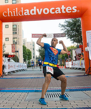 Superman Crossing the Finish Line