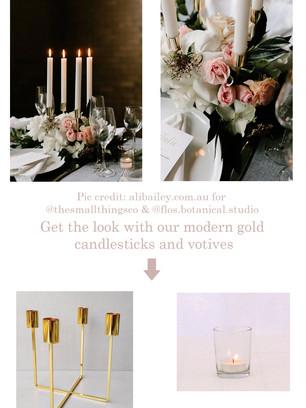 Modern gold candlesticks and glass votives