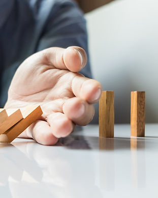 businessman-hand-stop-dominoes-continuou