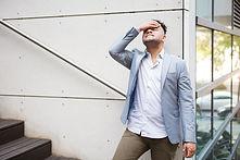 upset-hispanic-businessman-thinking-prob
