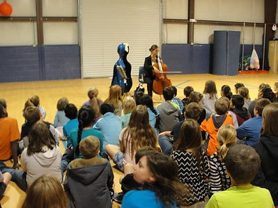 Demonstrating to students at middle school what music can do with art. #rosemarybeachfoundation