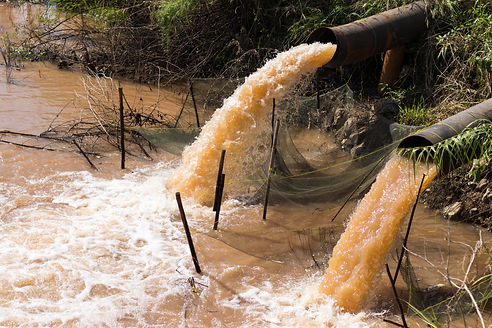 Close up of water gushing from the sewer