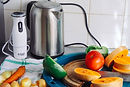 gray-metal-electric-kettle-near-sliced-v