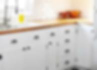 white_kitchen_cabinet_hardware.webp