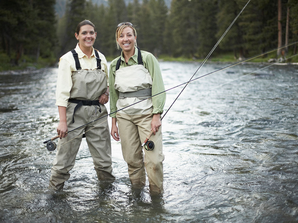 Two friends fly fishing as a hobby