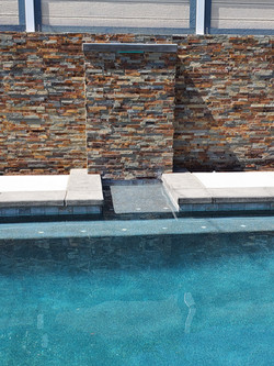 waterfall feature into pool