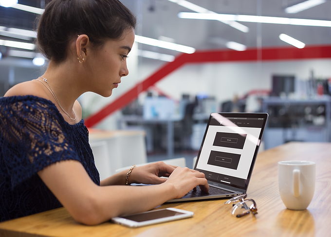mockup-of-a-girl-working-with-a-macbook-