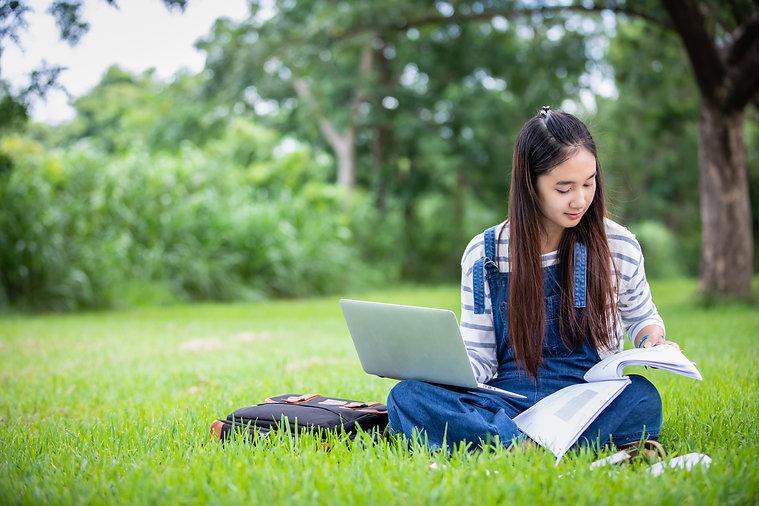 beautiful-asian-girl-student-holding-boo