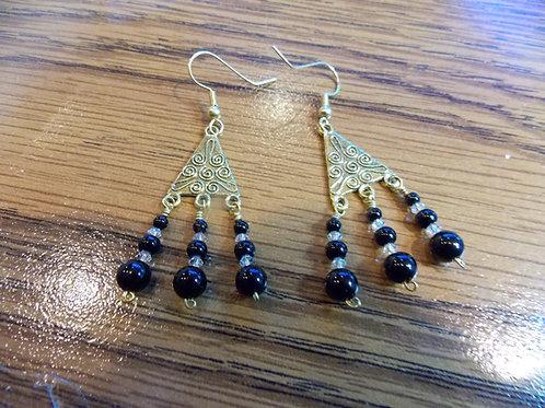 Gold dangle earrings with black onyx