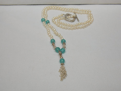 White pearl necklace with blue beads