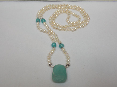 Freshwater pearl necklace with blue quartz pendant