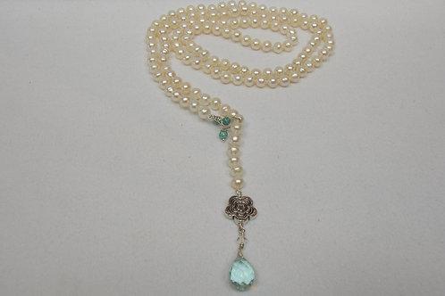 White pearl necklace with quartz pendant