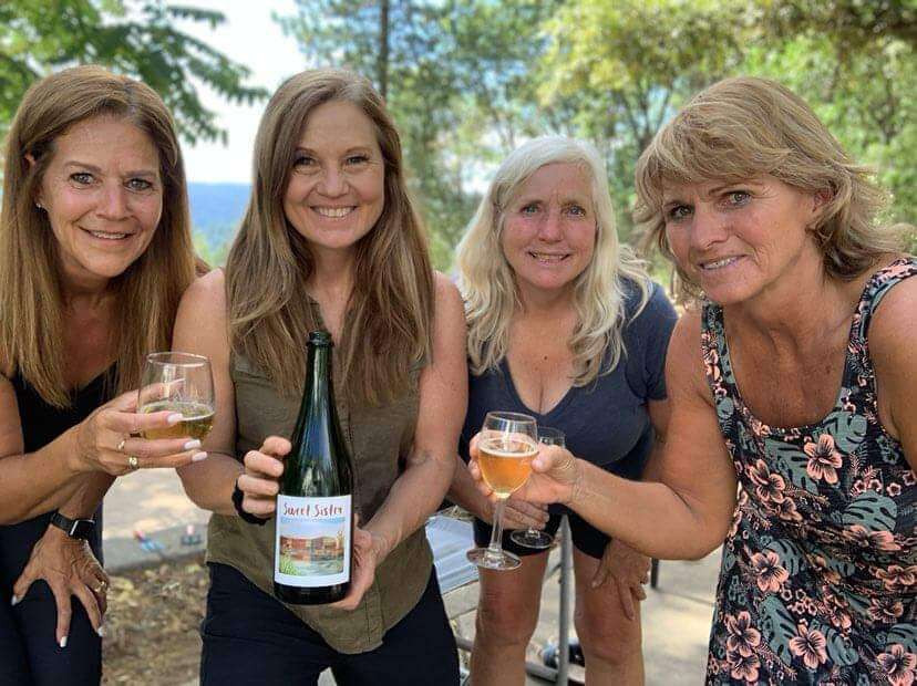 mid life women enjoying wine