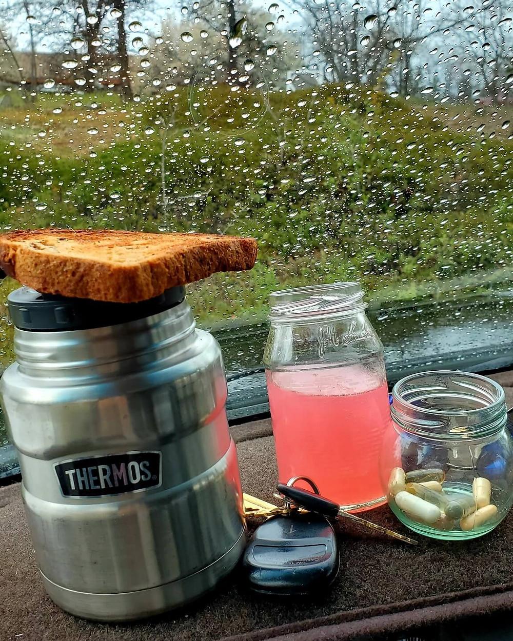Food drink and vitamins on vehicle dashboard