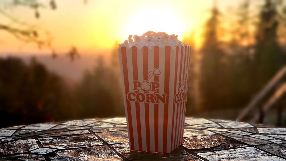 box of popcorn at sunset