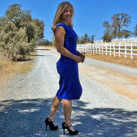 roberta in blue dress with white picket