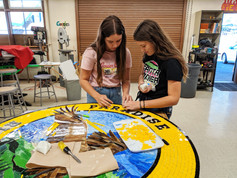 Students at work on the medallion