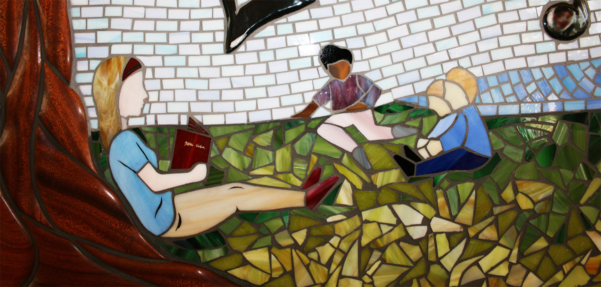 Colorful mosaic tree mural at Lincoln Acres Library