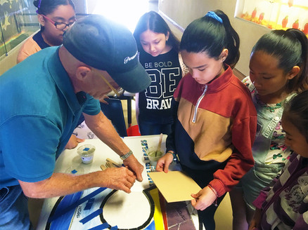 Students at work on the Euclid Eagles Soar High letters
