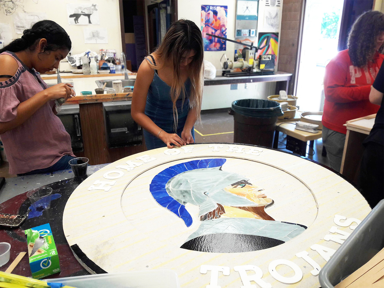 Students at work on the Trojan medallion