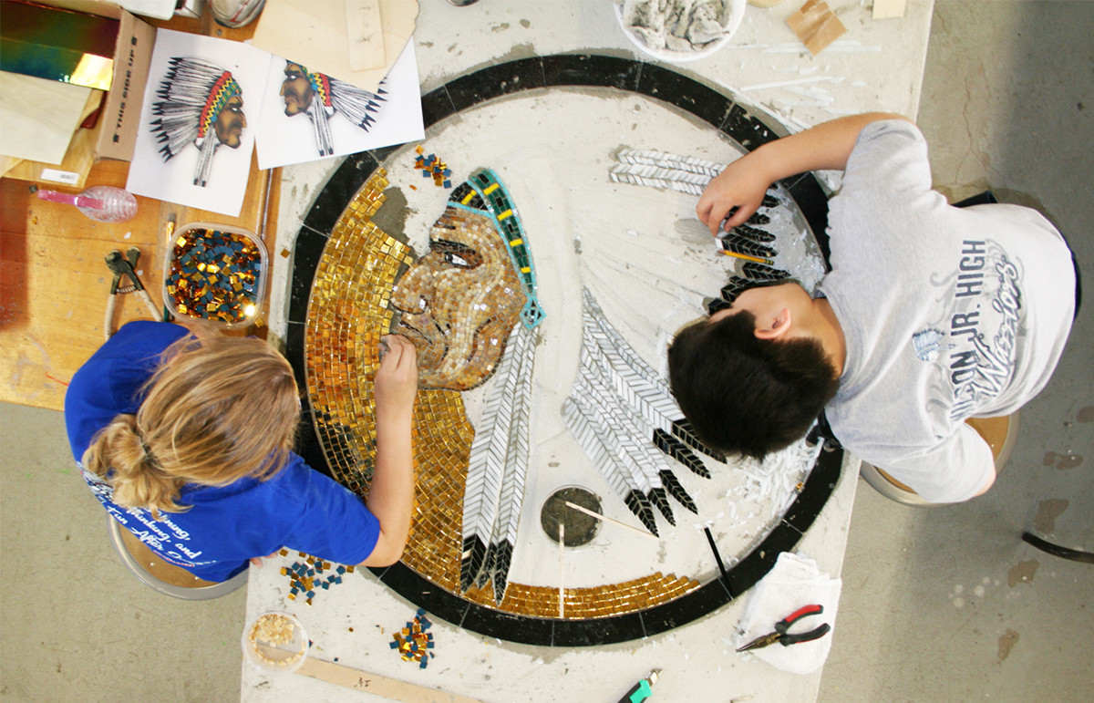 Students building one of the mosaic medallions