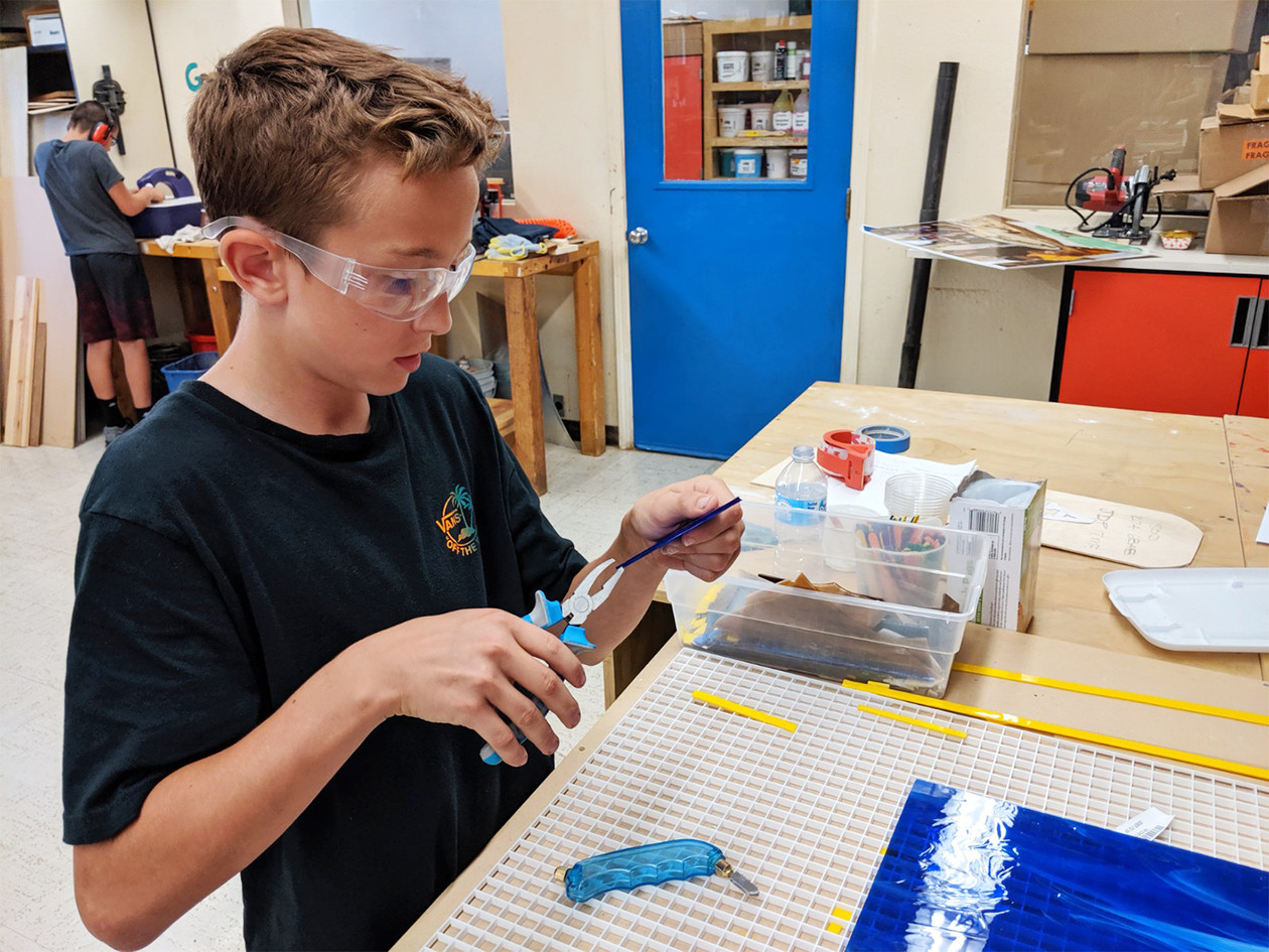 Student at work cutting glass for the medallion