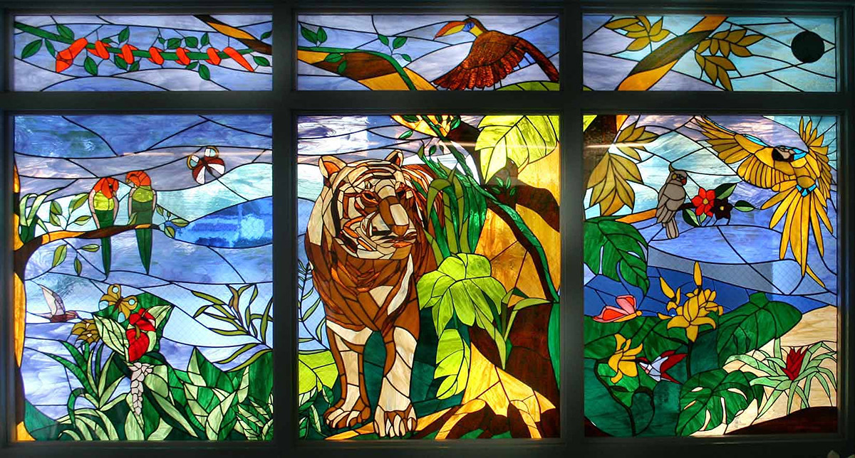 Colorful stained glass mosaic tiger in jungle at Wilson Middle School