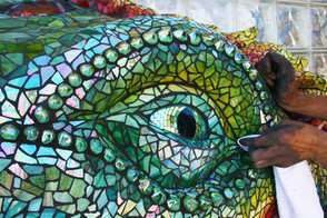 Giant mosaic iguana sculpture at Ibarra Elementary School