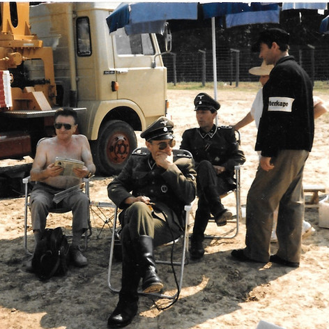 Blatt and various actors on set