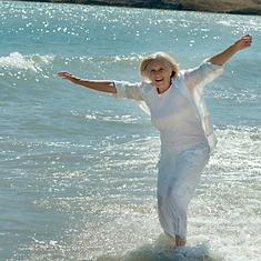 older woman in ocean.png