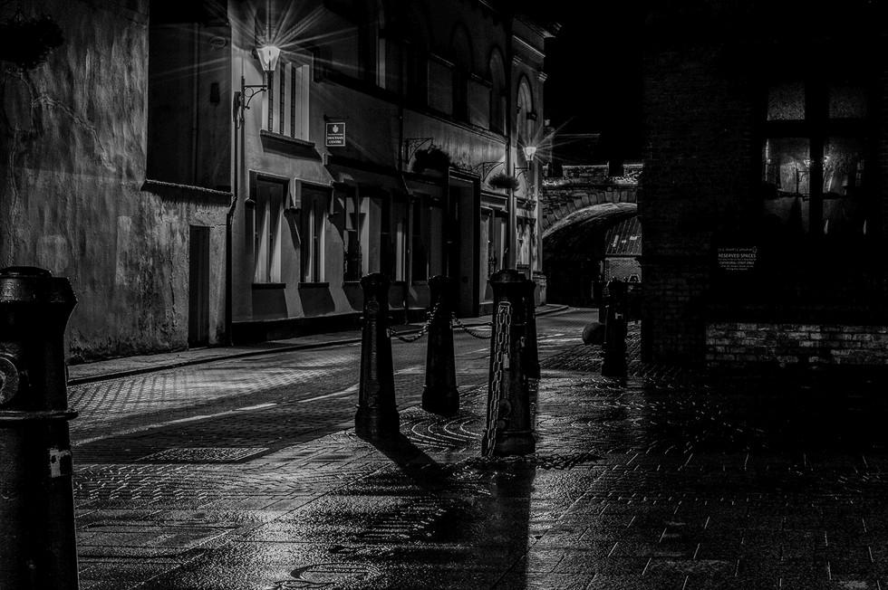 'Dark Street Derry' by Brendan Davitt ( 11 marks )