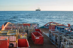 offshore supply boat with containers and